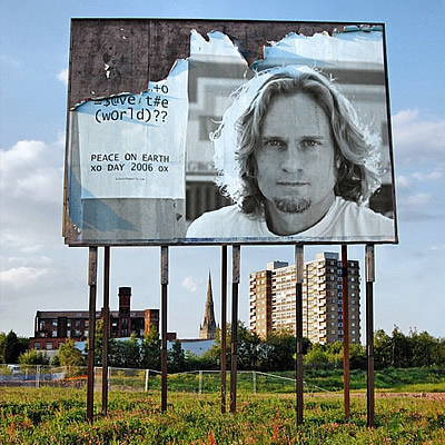 Roy Shabla and a billboard of his graffiti art
